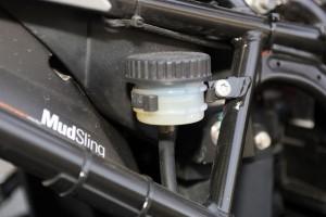 The unprotected rear break fluid reservoir