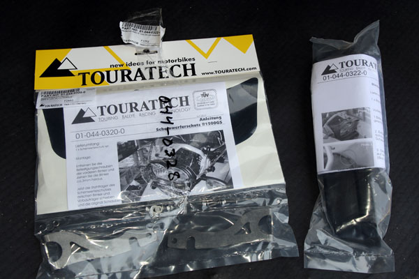 The Headlight Protector and Anti-Glare Shield Set from Touratech